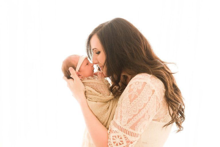 A mother kisses her baby | Sweet Beginnings Photography by Stephanie | Natural Light Newborn Photography