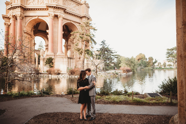 A couple embrace, captured by a Sacramento engagement photographer.