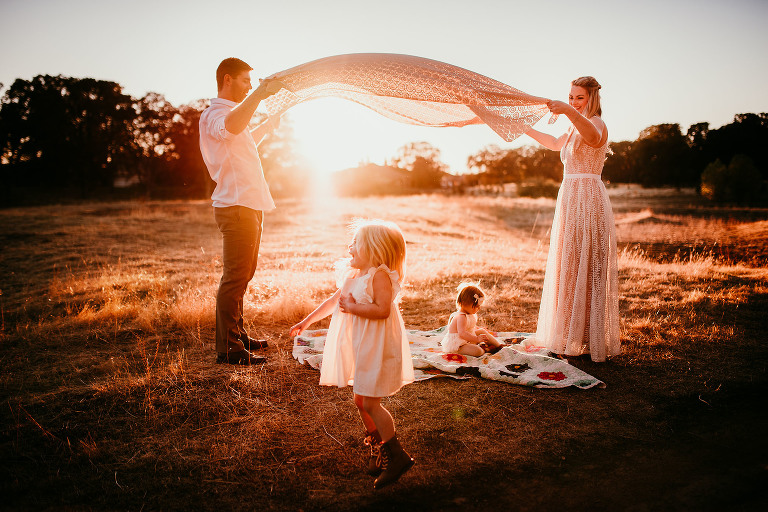 A girl runs under a blanket | Sweet Beginnings Photography by Stephanie | Sacramento Newborn and Family Photographer