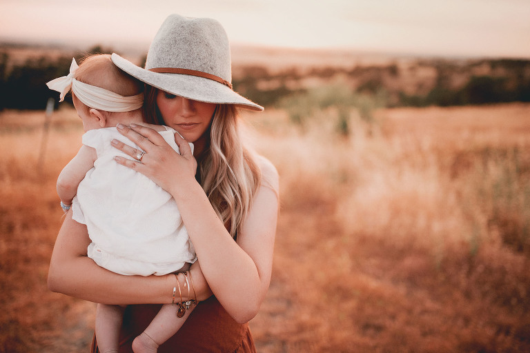 A mother holds her child   Sweet Beginnings Photography by Stephanie   Sacramento Area Family Photographer