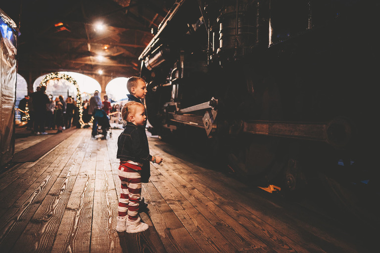 A girl looks at a train | Sweet Beginnings Photography by Stephanie | Polar Express