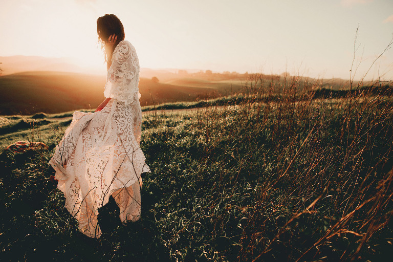 A woman's dress flows in the wind.