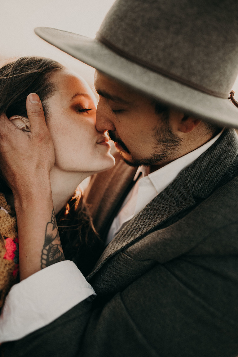 A man pulls his fiance in for a kiss.